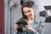 Photographer posing in a professional studio — Stock Photo