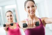 Sporty girls weightlifting at gym — Stock Photo