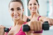 Cheerful women exercising at the gym — Stock Photo