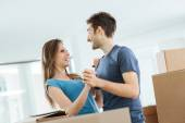 Happy couple dancing in their new house — Stock Photo