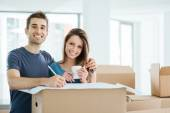 Happy couple designing their new house — Stock Photo