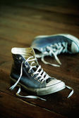Old sports shoes — Stock Photo