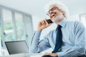 Happy businessman on the phone — Stock Photo