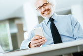 Businessman using a touch screen phone — Stock Photo