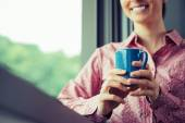 Relaxing coffee break at window — Stock Photo
