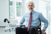 Successful businessman overcoming disability — Stock Photo