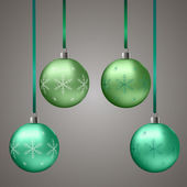 Groene kerstballen met sneeuwvlokken — Stockvector