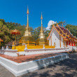 Twin golden pagoda in front of Buddhist church at Wat Phra Thart — Stock Photo #62981209
