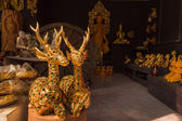Gilded wood carving deer sculpture at Thai wooden sculpture shop — Stock Photo