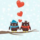 Two owls on tree branches with hearts — Stock vektor