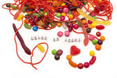 Trick or Treat candy spilling out onto white background — Stock Photo