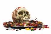 Halloween party with trick or treat candy skull dish — Stock Photo