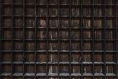 Old, distressed, dark wood storage shelves with random tools — Stock Photo
