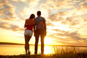 Romantic Couple Watching the Sunset — Stock Photo