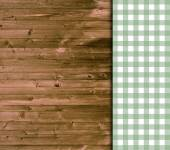 Traditional wooden background with green white tablecloth — Stock Photo