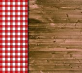 Traditional wooden background with red white tablecloth — Stock Photo