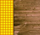 Traditional wooden background with orange yellow tablecloth — Stock Photo
