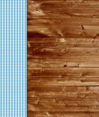 Traditional wooden background with blue white tablecloth — Stock Photo