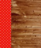 Traditional wooden background with red tablecloth — Stock Photo
