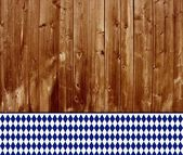 Traditional wooden background with bavarian tablecloth — Stock Photo