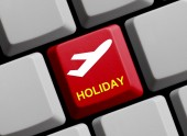 Red Computer Keyboard with Plane Symbol showing Holiday — Stock Photo