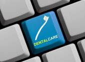 Computer Keyboard with Symbol showing Dental care — Stock Photo
