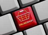 Computer Keyboard with Symbol showing Online Shop — Stock Photo