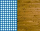 Traditional wooden background with tablecloth light blue and dark blue — Stock Photo