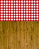 Traditional wooden background with tablecloth red white — Stock Photo