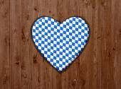 Wooden surface with symbol of blue white heart — Stock Photo