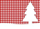 Christmas background - tablecloth red white with white fir tree — Zdjęcie stockowe