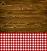 Wooden planks with vintage tablecloth red and white — Stock Photo