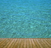 Jetty wooden with clear blue water — Stock Photo