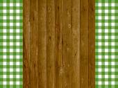 Wooden planks with vintage green white tablecloth — Stock Photo