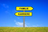 Signpost showing family or career german — Stock Photo