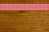 Wooden vintage background withred white tablecloth — Stock Photo