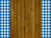 Wooden background with two blue stripes tablecloths — Stock Photo