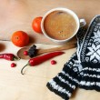 Hot coffee and a warm , natural mittens — Stock Photo #57336017