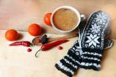 Hot coffee and a warm , natural mittens — Stock Photo