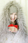 Christmas woman with gift smiling — Stock Photo