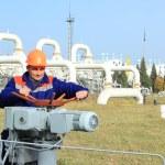 Worker turns bypass valve — Stock Photo #59267011