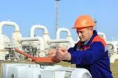 Worker opening bypass valve — Stock Photo