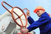 Worker turns big gas valve — Stock Photo