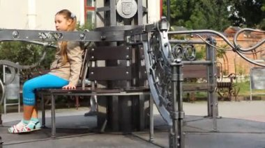 Girl Sits Rotates Carousel — Stock Video