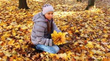 Girl Tosses Up Leaves — Stock Video