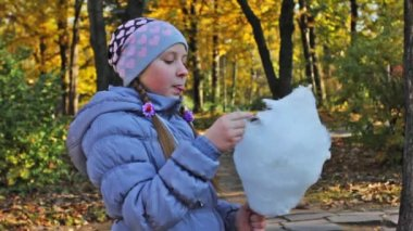 Girl Picks Off Pieces Cotton Candy — Stock Video