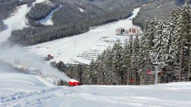 Snow Gun And Ski Lifts — Stock Video