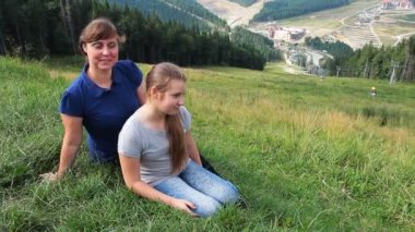 Mother With Daughter Sit On Green Grass — Stock Video