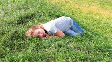 Young Girl Lies On Really Green Grass — Stock Video