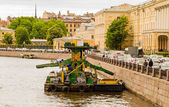 Moored to a quay, old dredging platform in the river — Stock Photo